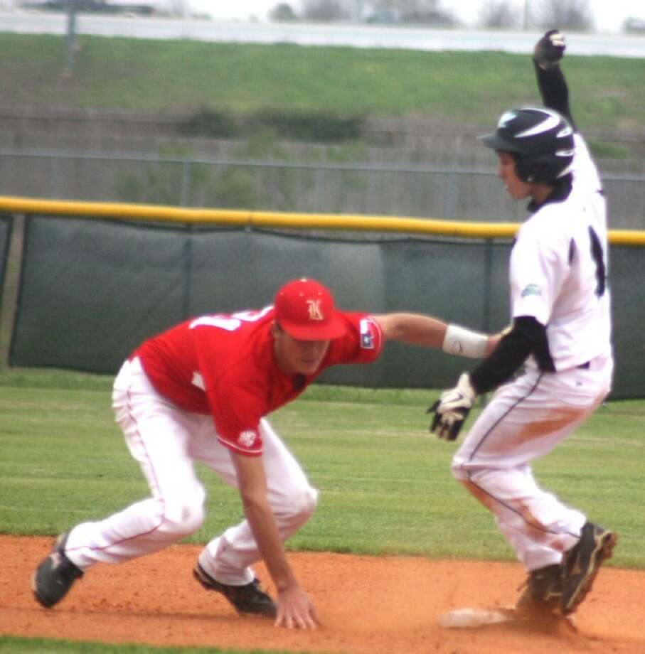 Memorial's Adam Lopez slides into second base with a stolen base as Katy shortstop Dylan Gaffney applies the late tag in the season opener for both teams Monday. Katy went on to win the game in extra innings 7-3. Photo: Robert Avery