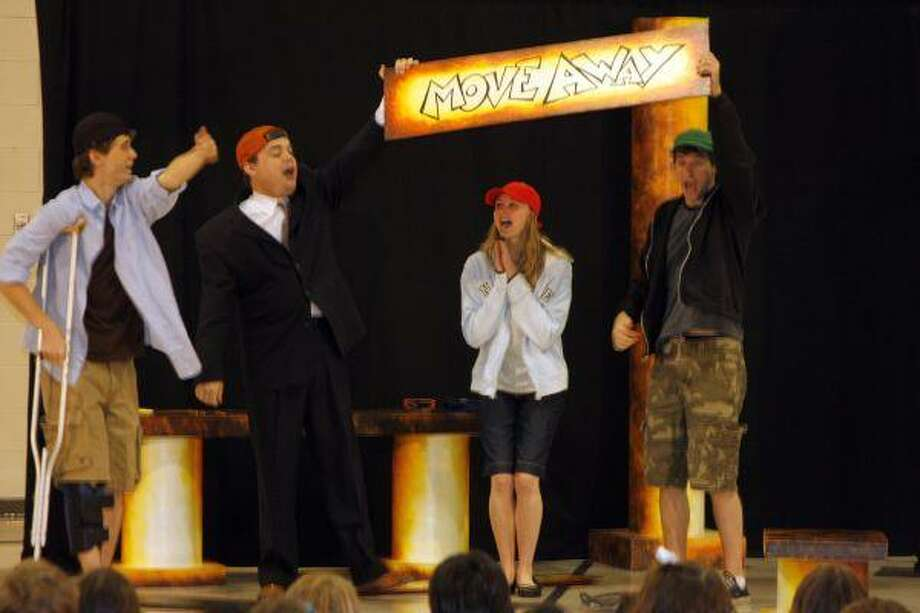 """The A.D. Players of Houston recently performed for Pattison Elementary students the play Biff, Bang, Kapowie! by Gillette Elvgren. As well as entertaining the students, the performers taught them strategies for dealing with bullies. Pictured are the actors rapping to the suggestion of """"moving away"""" from the bully."""