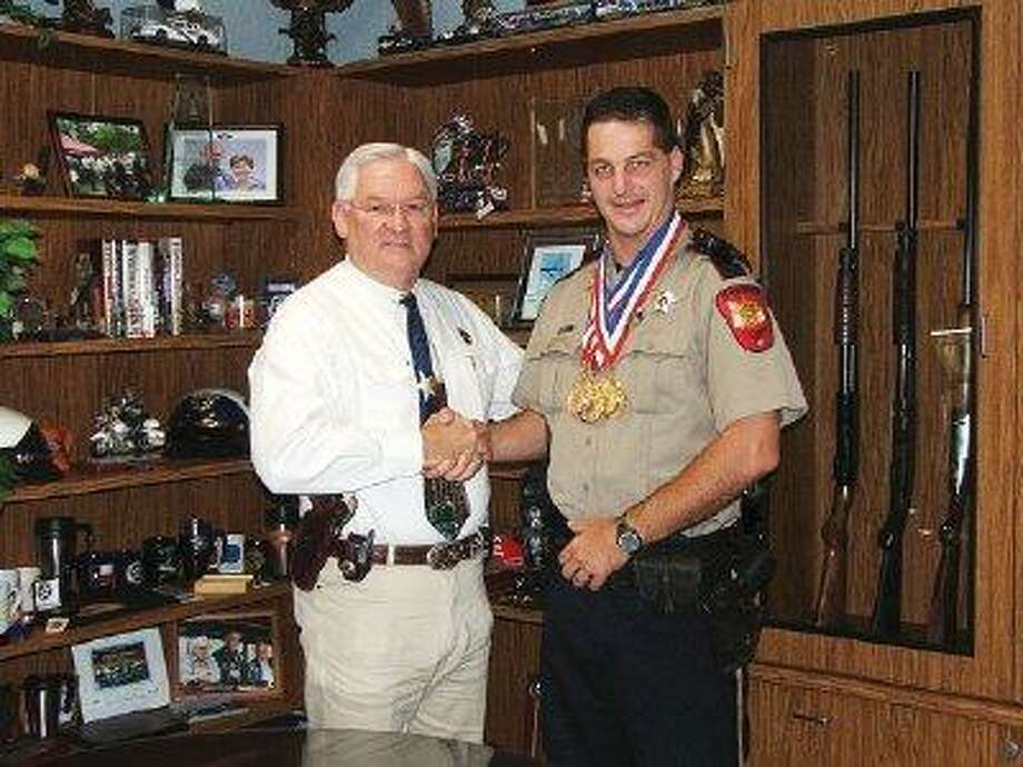 "Montgomery County Sheriff's Office patrol deputy Dawson ""Trey"" Weatherford, right, is pictured with Sheriff Tommy Gage. Weatherford recently earned five gold medals and one silver medal at the Texas Police Games in Brownsville and Gage served as Weatherford's sponsor for the competition."