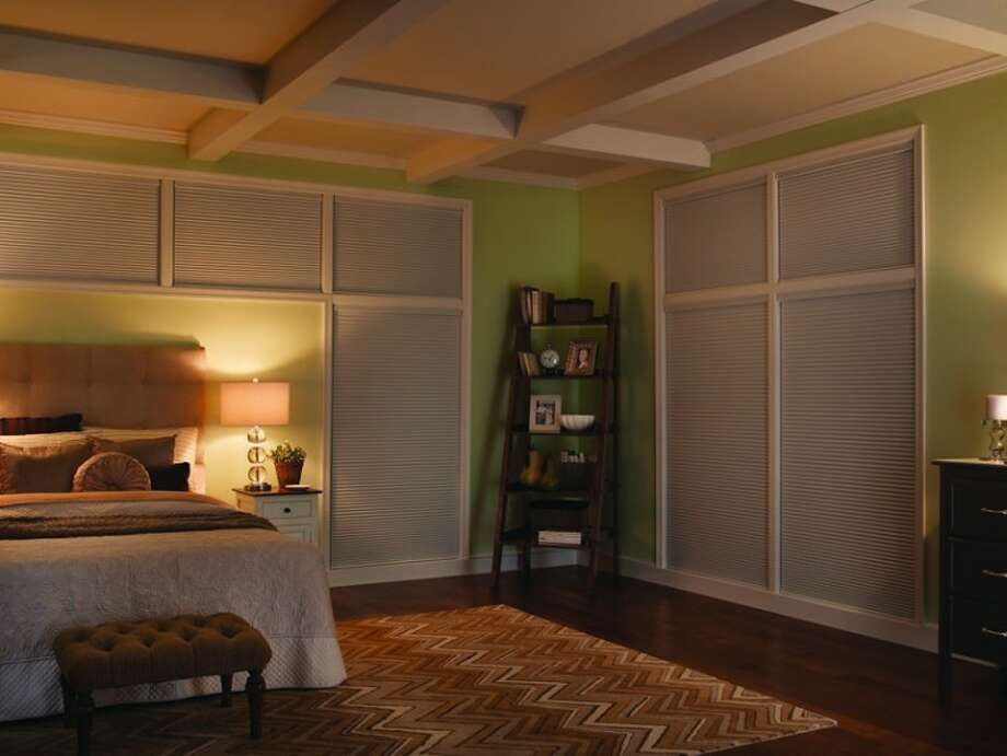 Specialized window shades can block out the light as well as save on energy bills.