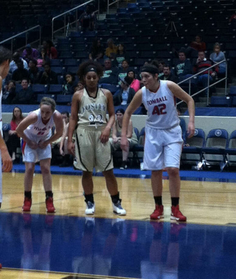 The Tomball Lady Cougars (29-6) basketball team beat Pearland Dawson 46-35 Tuesday night in the Region 3-4A quarterfinals at Don Coleman Coliseum. They have now won 13 in a row and will face Plugerville Connally in the regional semifinals Friday at 3:30 p.m. at the Campbell Center in Aldine. Above, junior post player Carissa Diaz (42) helped lead the Tomball Lady Cougars to those wins. Photo: David Fannuchi