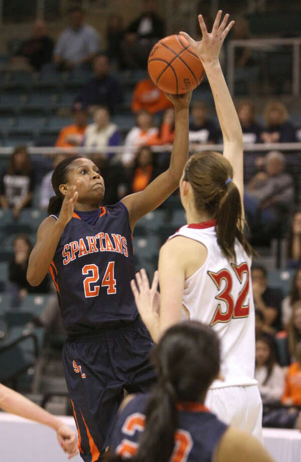 Seven Lakes' Christen Inman puts up a shot over Cy Woods' Nancy Mulkey during their Region III-5A quarterfinal Feb. 19 at the Merrell Center in Katy. Inman scored 36 points as Seven Lakes advanced with a 61-51 overtime victory. Visit www.hcnpics.com for more photos. Photo: Alan Warren/HCN