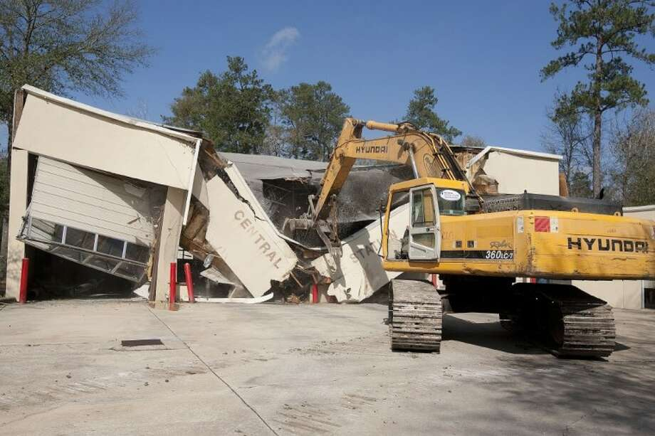 The Woodlands Central Fire Station is demolished Tuesday to make room for a new station. Photo: Karl Anderson