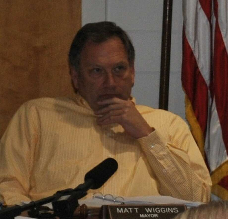 Former Kemah Mayor Matt Wiggins (shown at a March 2011 council meeting) is suing 10 people who he claims have publicly made false statements about him.