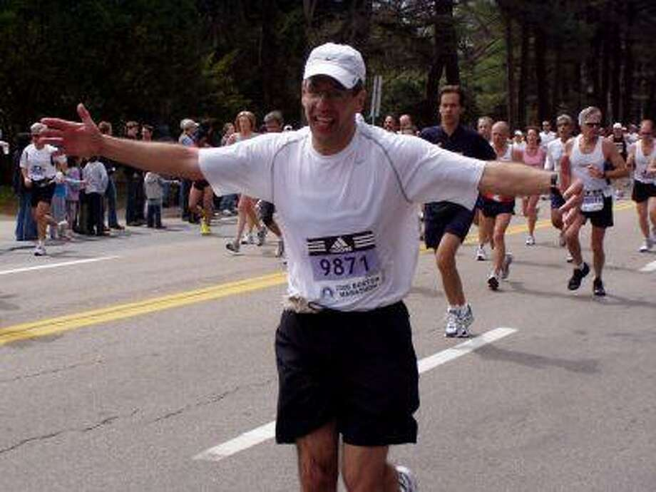 The Woodlands' Vince Attanucci enjoys his experience while running in the 2006 Boston Marathon.