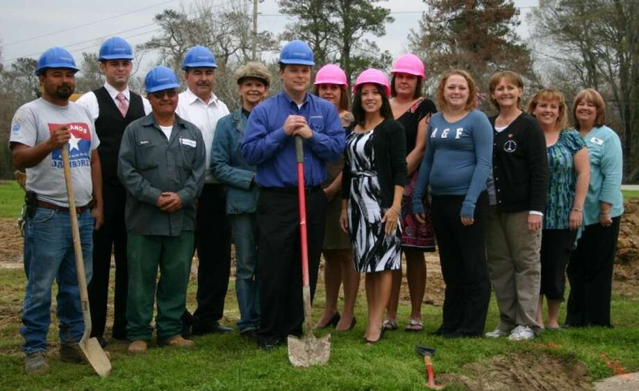 The staff of Sterling-White Funeral Home and Cemetery, joined by representatives of the Highlands Chamber of Commerce and the Crosby/Huffman Chamber of Commerce, breaks ground Feb. 20 at the construction site on which Sterling-White's new mausoleum will be built. Holding the shovels are Managing Partner Jeff Moore, center, and colleague Moses Lopez. Photo: STEPHEN THOMAS