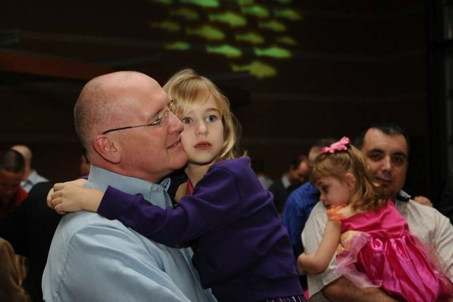 Dan Clift and Kyla Long enjoy a slow dance during the Pearland Daddy Daughter Date Night Saturday, Feb 18. Photo: KIRK SIDES