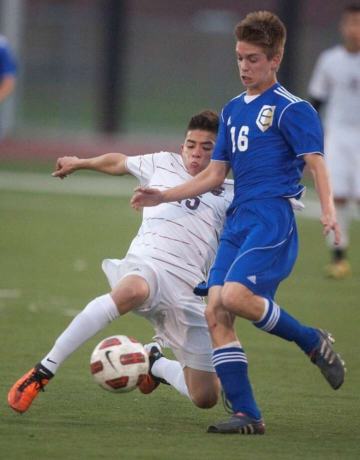 Elkins' Sam Konstanty fights for possession Tuesday night. The Knights advanced past the first round with a shootout victory over Pearland.