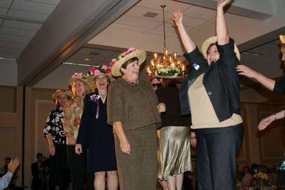 Faculty and staff with Lone Star College - Kingwood celebrate as their Eastr-inspired hats were chosen as the judge's favorite in the group category at the annual Ladies Luncheon and Easter Bonnet contest April 1. The luncheon also serves as a kick off for the Picnic on the Park celebration in Town Center April 11 which proceeds from the luncheon and Picnic benefit the Village Learning and Achievement Center.