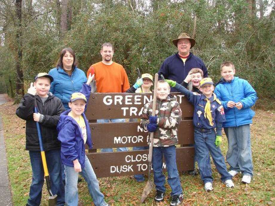 Wolf Pack 888 Den 4 Cub Scouts from Hidden Hollow Elementary performed a conservation project recently in Mills Branch Village. They walked along the greenbelts in Mills Branch and planted acorns to replenish those trees lost during Hurricane Ike. The Cub Scouts who helped were, from left, Taylor Coffman, Casey Turner, Pierce Dietrich, Kamren Barrows, Hunter Thomas, Braeden Jermain and Chase Coffman. Also pictured are Assistant Den Leader Selena Barrows, Scout parent Darrell Jermain and Den Leader Clark Turner.