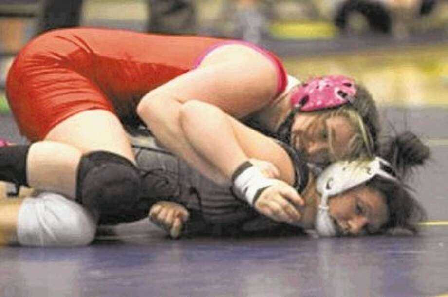 The Woodlands' Lindsey Spjut wrestles during the District 9-5A tournament. / @WireImgId=2615838