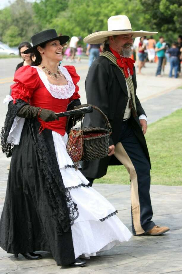Re-enactors portray a Mexican lady and gentleman at Presidio La Bahia during the 175th anniversary of the Goliad Massacre.