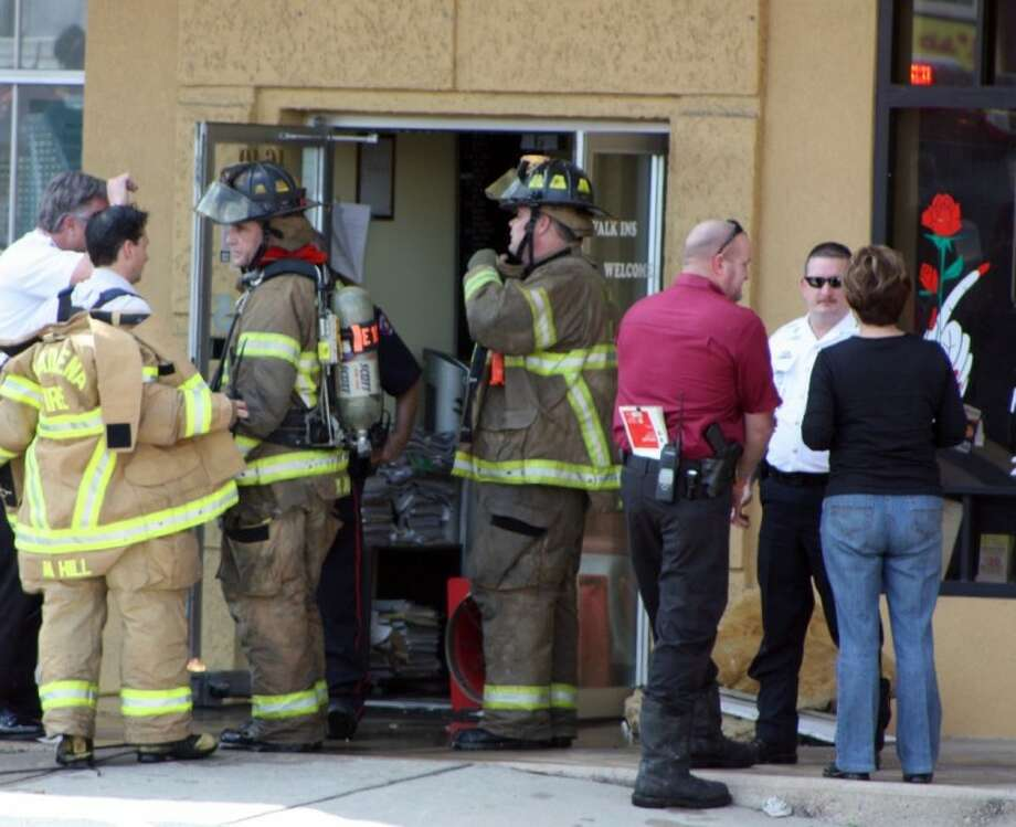 Pasadena and Seabrook firefighters were called to put out a fire at the LN Nails salon in the 4600 block of NASA Parkway Wednesday afternoon. Photo: KRISTI NIX