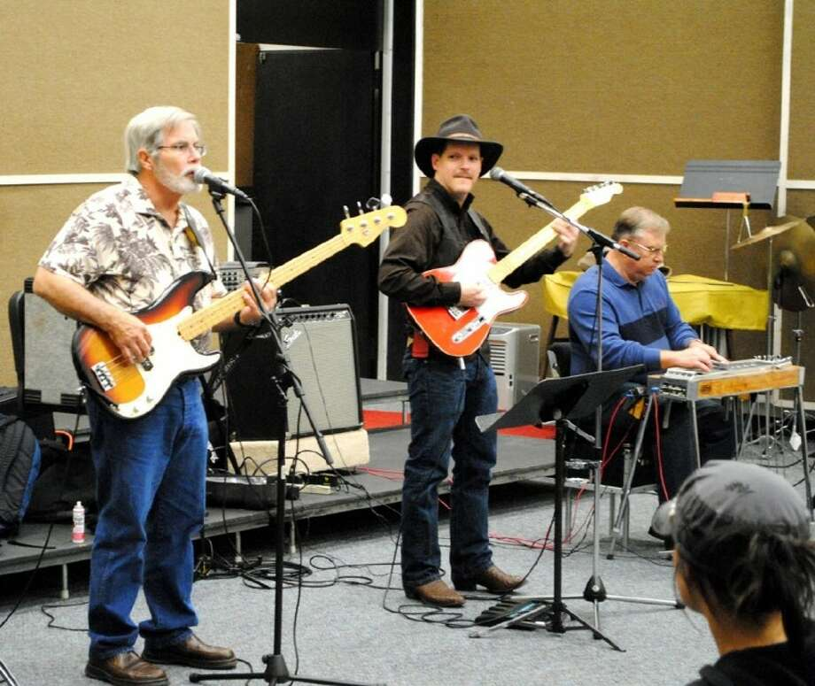 Alvin Community College students listen to the Rambler band during a class on country music on Monday, February 20. Band members on the stage from left are Travis West, of Richwood, Larry Schoppe, of Lake Jackson, instructor James Harvey and Tim Marlin of Lake Jackson. Photo: ACC