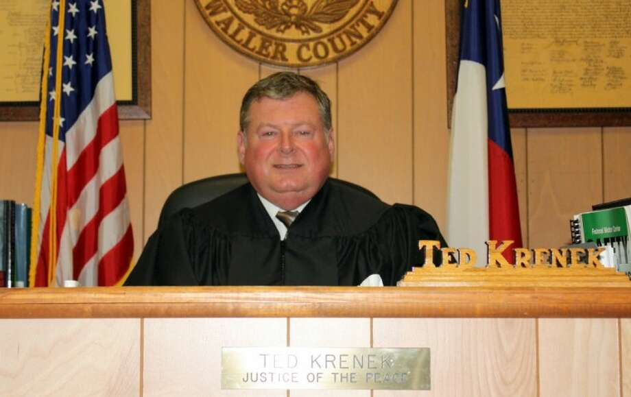 Justice of the Peace Ted Krenek sits at his bench in the Precinct 4 office. He has become the judge that officials turn to in a pinch. He filled in for Judge DeWayne Charleston for a year and has now been appointed to the part-time position of Brookshire municipal judge.
