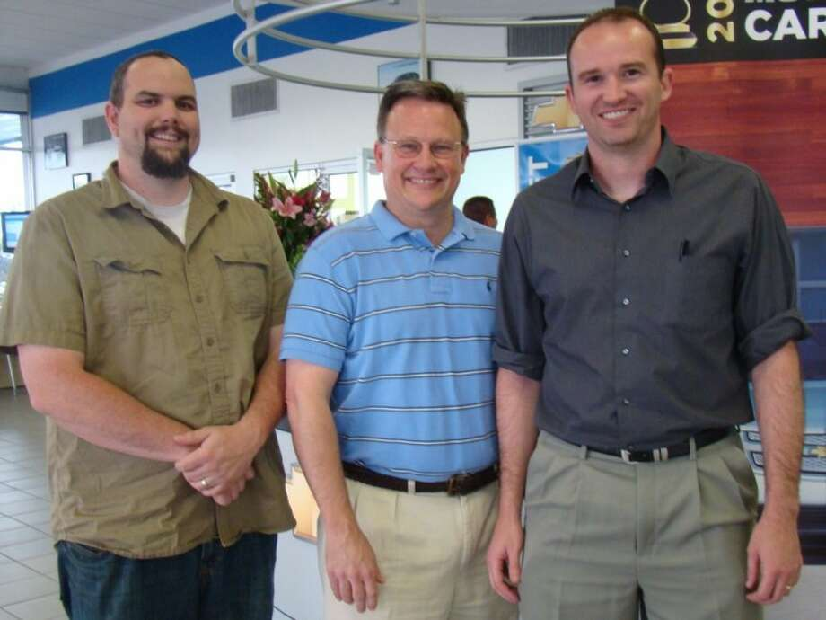 Taking time out from saving souls, these three University Baptist Church ministers stopped by the Clear Lake Chevrolet dealership last week to check out the new all-electric Chevy Volt and bless it and the crowd. They are, from left, Youth Minister Kyle Wilson, Minister of Music Matt Marsh and Senior Pastor Steve Laufer.
