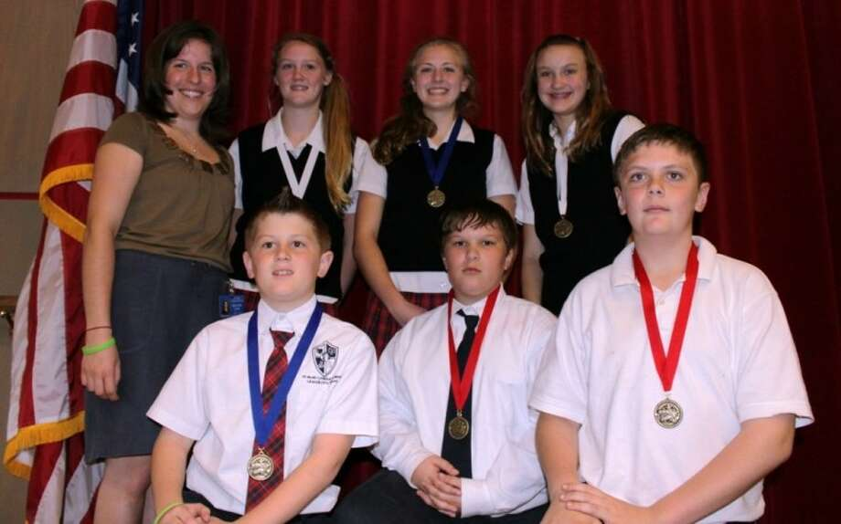 Students at St. Mary's Catholic School in League City celebrate recent wins at the University of St. Thomas Archdiocesan Essay Contest and the Annual Archdiocesan Science Fair.