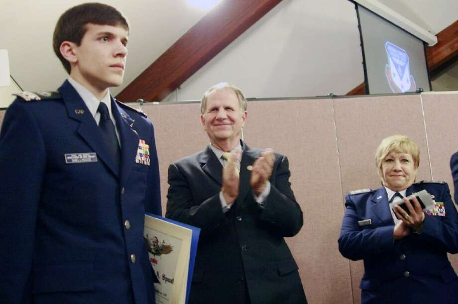 Cadet Col. Daniel Shellhouse receives applause from Congressman Ted Poe and Col. Brooks Cima of the Texas Wing Commander at the ceremony at which Shellhouse was presented the General Carl A. Spaatz Award Feb. 20.