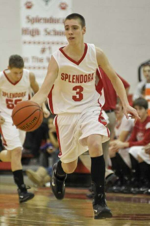 Kevin Norton, seen here in Splendora's win over Liberty Dec. 18, led the Wildcats with 19 points in a double-digit win at Huffman last Tuesday. / © by Jose Quiroz 2009