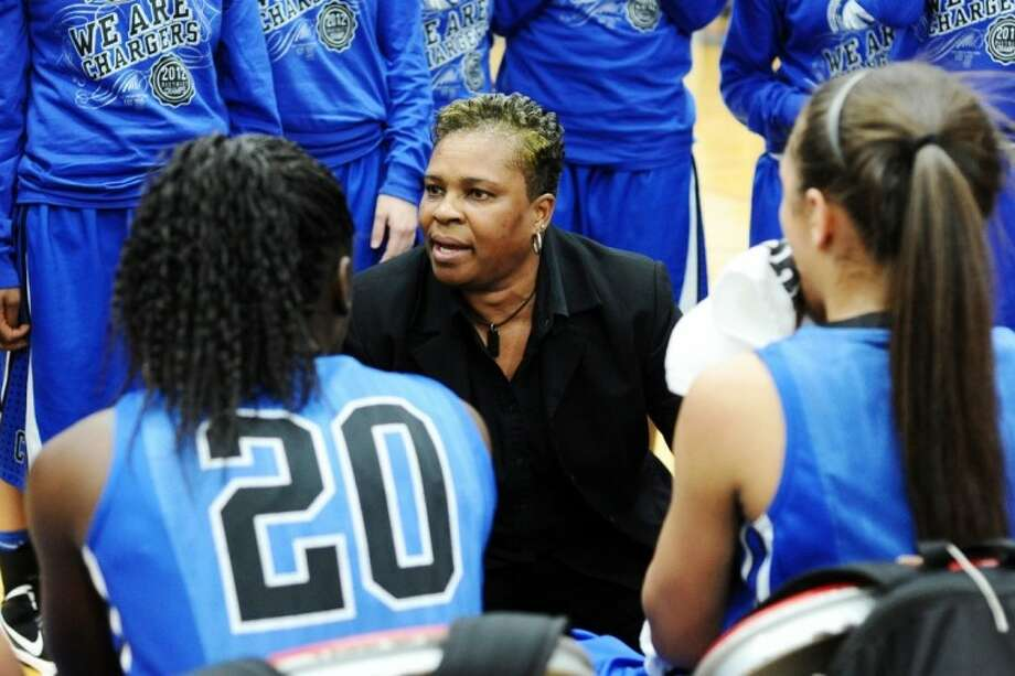 Clear Springs head coach Pam Crawford talks to her team during the Lady Chargers' 81-51 win over Sugar Land Clements Tuesday night in a Class 5A girls' bi-district basketball game. Photo: KIRK SIDES