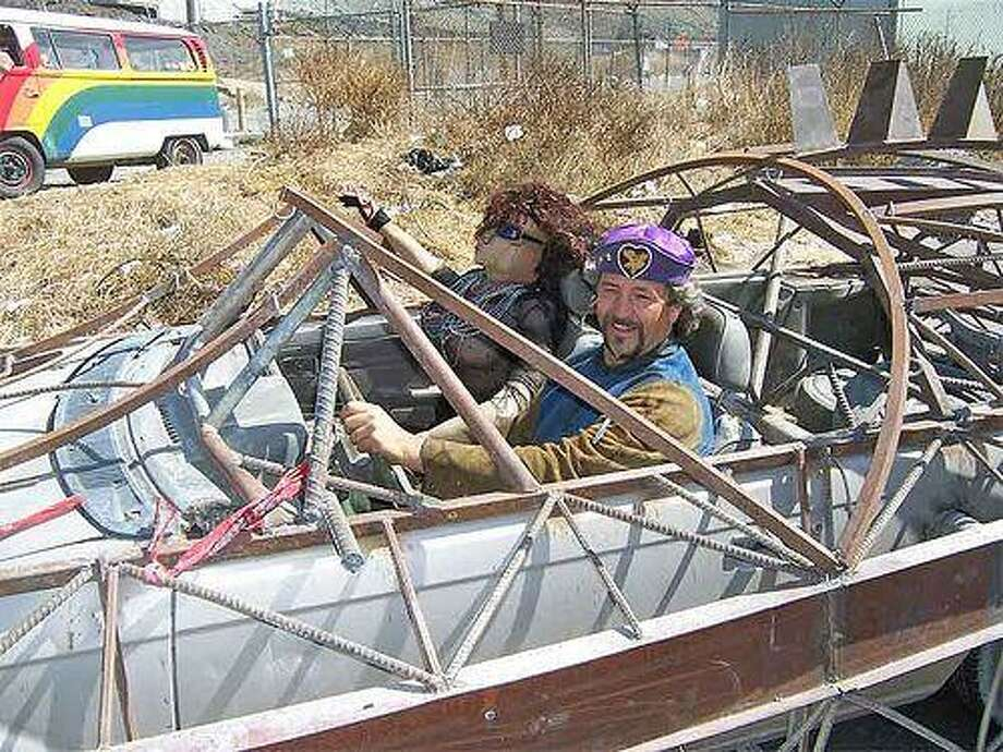 """Tom Kennedy, whose association with the Houston Art Car Parade led to national recognition as a mobile sculptor, drowned Sunday at a California beach. He was 48. A film featuring Kennedy, """"Automorphisis,"""" had already been scheduled for screening by the WorldFest-Houston International Film Festival at 5 p.m. Sunday."""