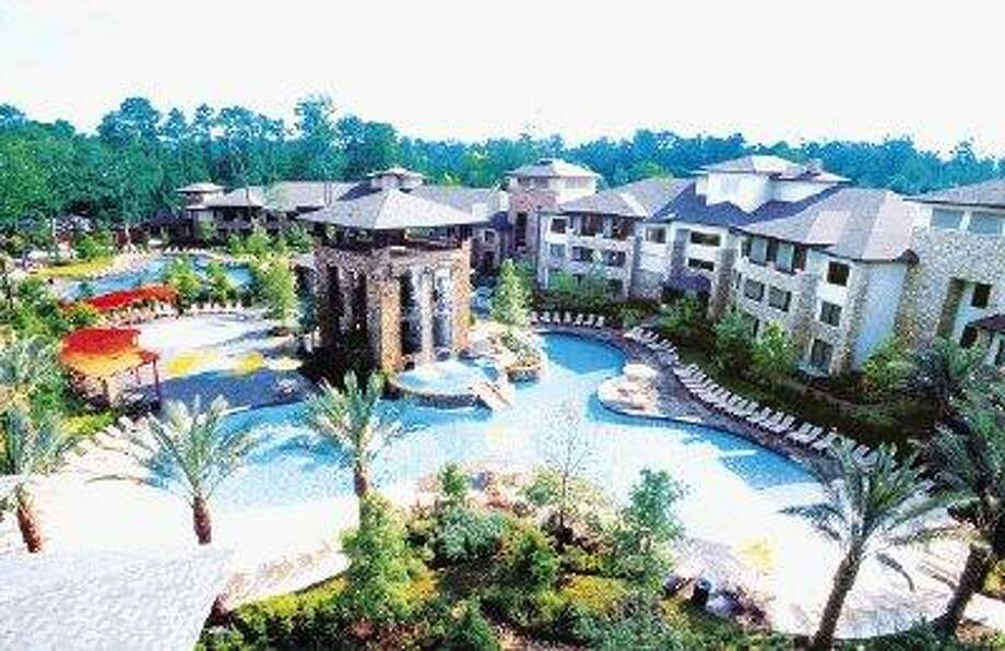 The Woodlands Resort's Forest Oasis Waterscape will occupy children and adults from dawn til past dusk with a zero-grade entry toddler pool, pop fountains, double-helix racing slide and relaxing lagoon-style pool. / @WireImgId=747090