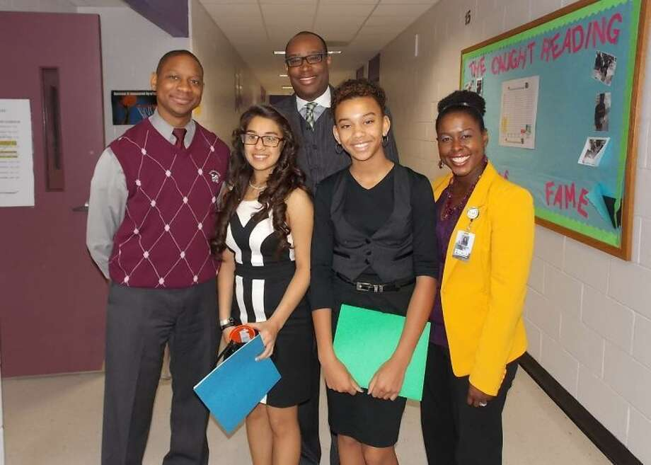 Pictured with Houston Councilmember Larry Green (back row) are (from left) Algrenon Nelson, CMMS Dean of Instruction; students Janice Fandino and Morgan Batiste; and Richerica Wolf, CMMS Eighth-Grade Counselor.