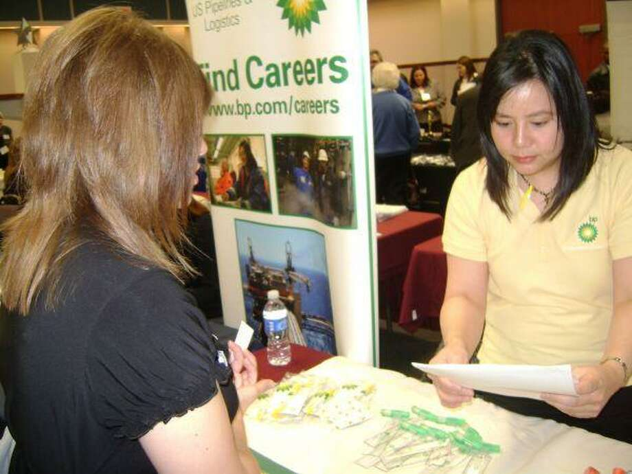 Bethany Guerra (left) receives information about British Petroleum from Ruby Lim, one of the company's representatives, at the San Jacinto College North Career Expo, April 7.
