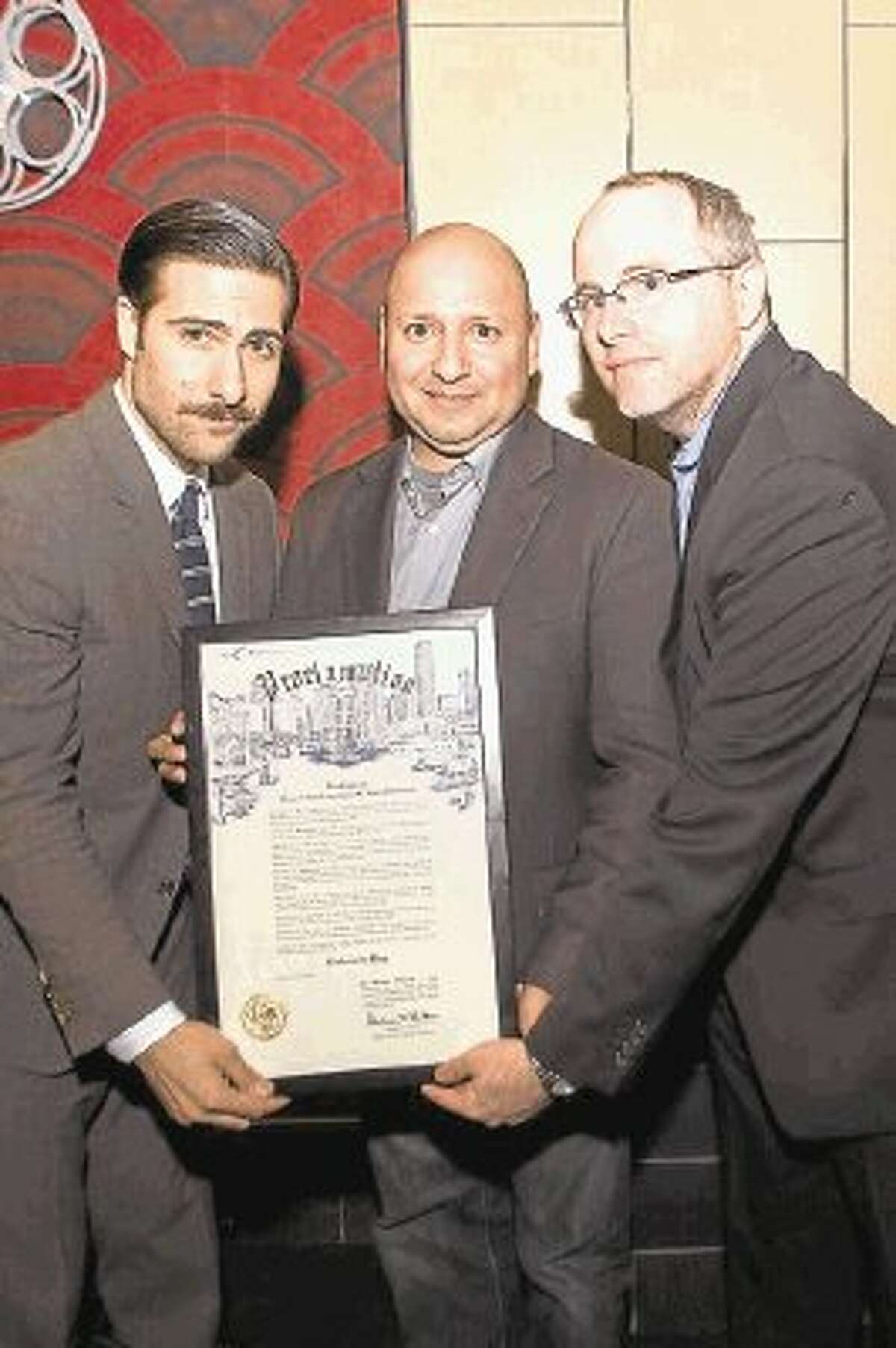 Schwartzman (left) was presented a proclamation by the City of Houston for the official Rushmore Day from Alfred Cervantes of the Houston Film Commission and Joshua Starnes of the Houston Film Critics Society.
