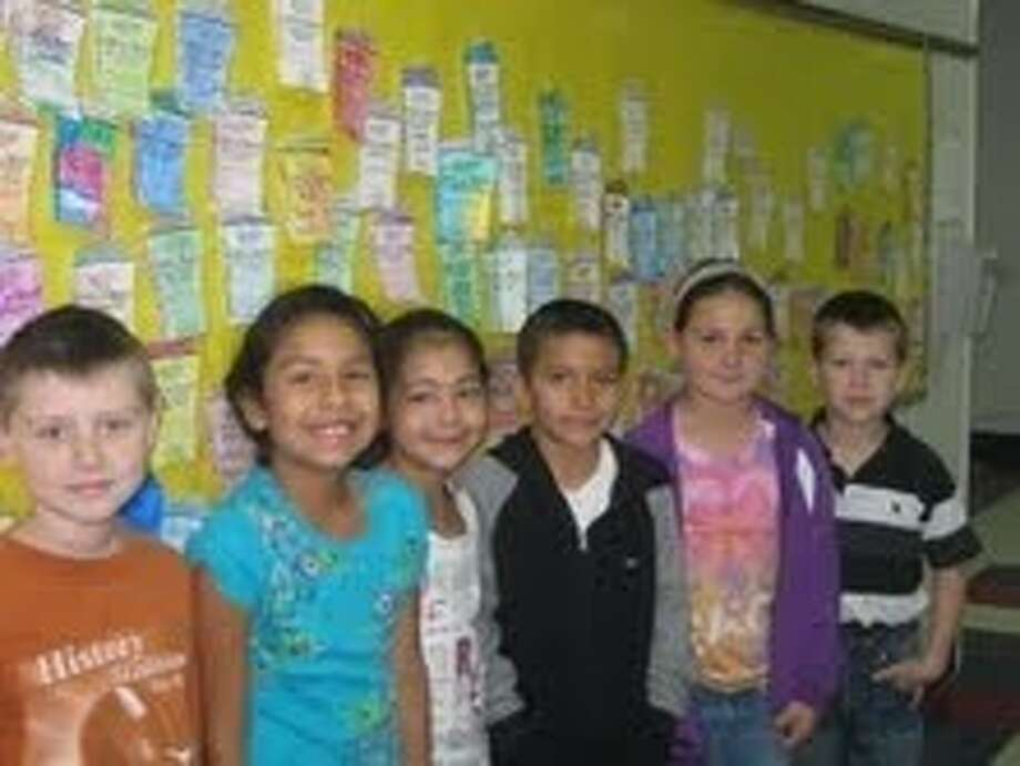 The wall at Shepherd Primary with donation slips brought by students and representatives. Shown from left to right: Trevor Fontenot, Valentina Beiza, Brisia Espinoza, Isaih Torres, Makayla Morton and Blaine Chreene. Photo: Submitted Photo