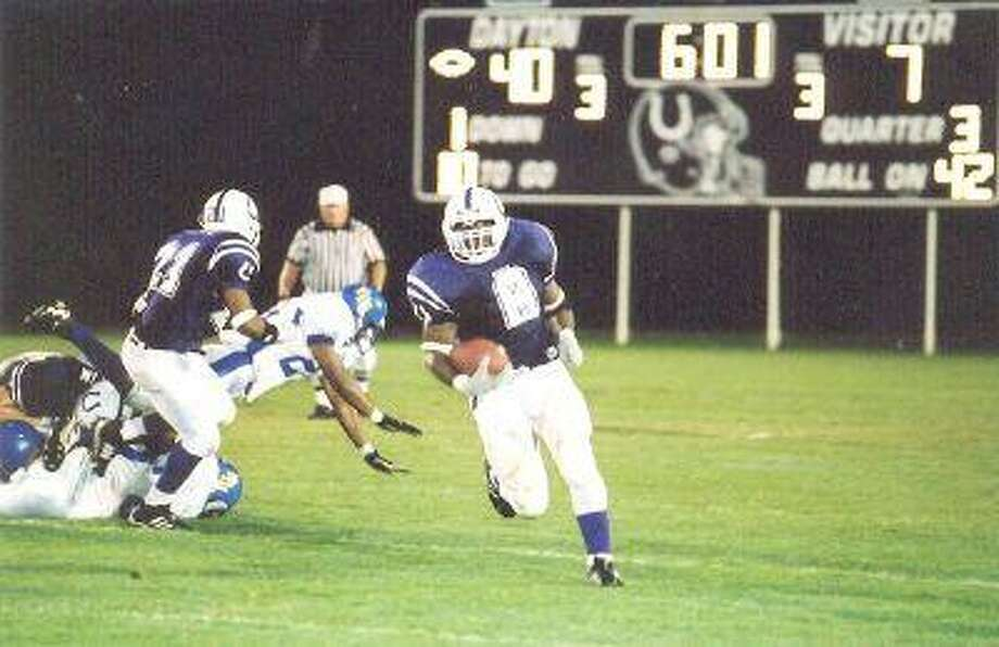 Lamar Mitchell breaks loose against Forest Brook during the Bronco's 54-26 win in 2002.