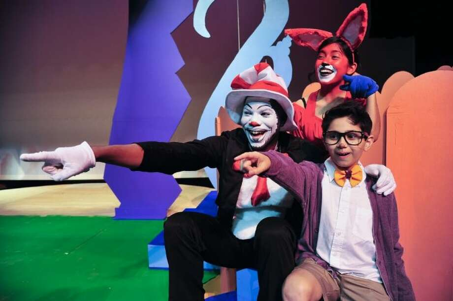 """The Cat in the Hat (Rich Scott from Pearland, left) shows JoJo (Nick Trevino, guest artist from Pasadena) a small Who, as Fox in Sox (Crystal Grimaldo from Galena Park) looks on in San Jacinto College's production of """"Seussical: The Musical."""" Photo: ROB VANYA"""