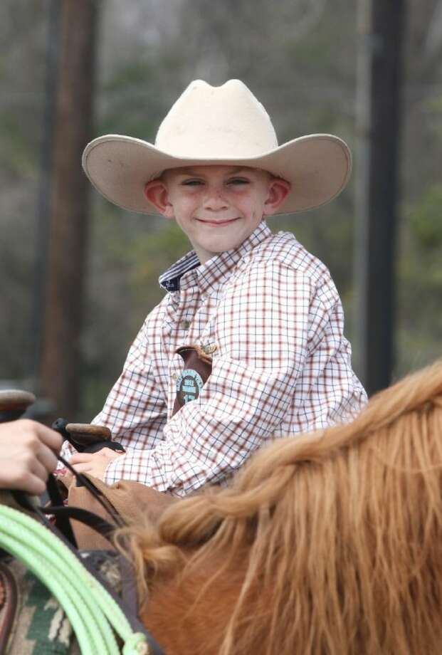 Ronnie Thrasher 6, on his horse during lunch break at Cullen Park in Katy on Thursday , February 23, 2012. (Photo by Alan Warren) Photo: Photo By Alan Warren