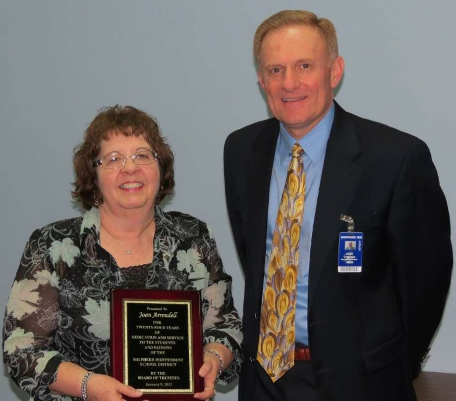 Shepherd ISD Superintendent Jody Cronin presents Joan Arrendell with a retirement plaque at the February school board meeting commending her on 24 years of service to the district. Photo: Submitted Photo