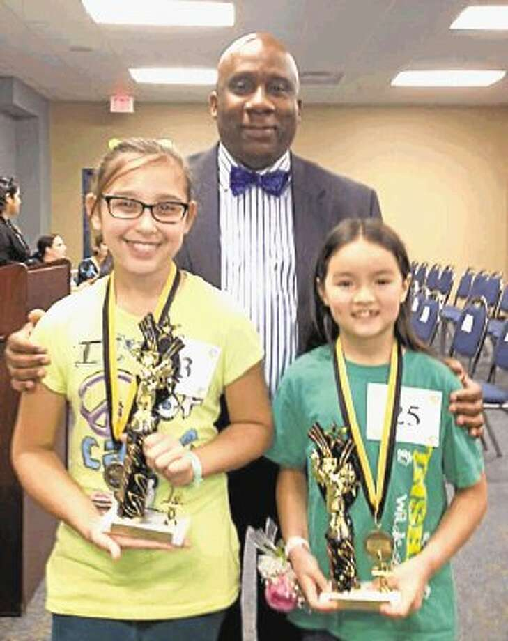 Spring ISD Spelling Bee winner, from left, Mya Briones, and runner-up Claire Chartrand are proud to display their trophies with Superintendent Dr. Ralph H. Draper. Smith Elementary Fifth Grader Wins District Spelling Bee / @WireImgId=2615992