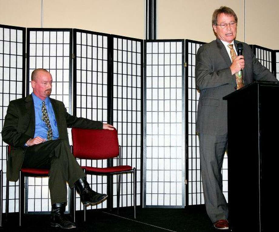 Zack Zbranek (seated, left) and Tommy Chambers (standing, right) discussed their qualifications for the position of County Court at Law Judge at a political forum held the night of Thursday, January 28. Candidates for all of the races that will represent the residents of Liberty County were invited to participate in the forum sponsored by the Cleveland Advocate and Dayton News.