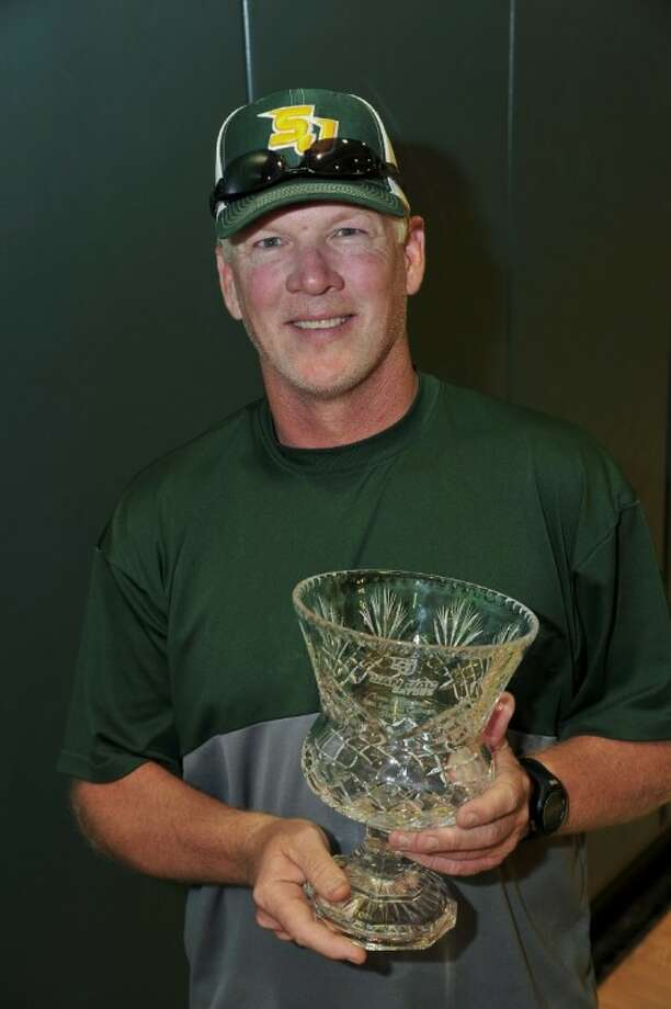 The San Jacinto College baseball team presented head coach Tom Arrington with an engraved vase to commemorate his 500th career win. Photo: Rob Vanya
