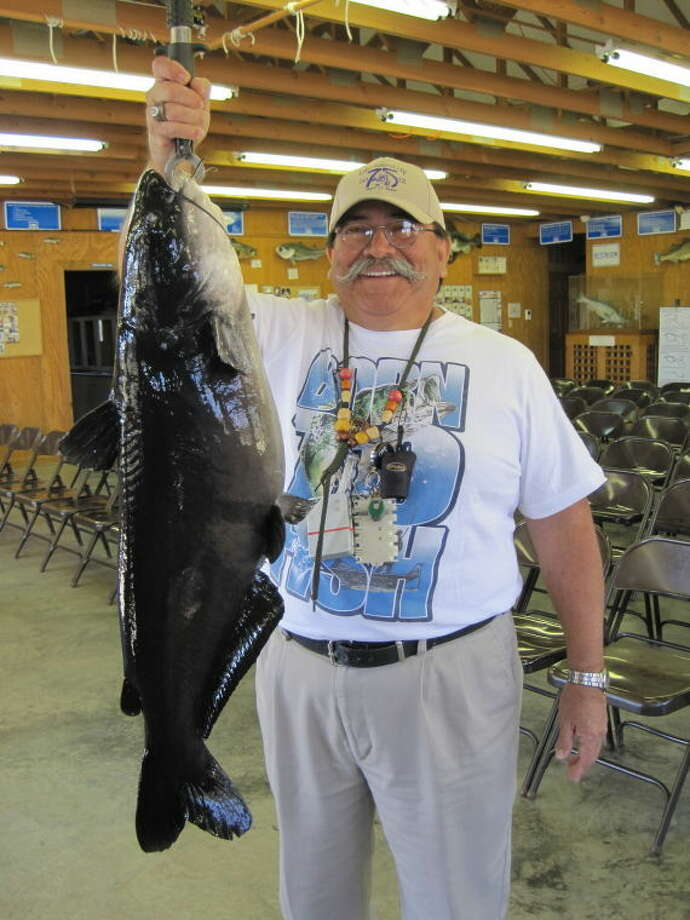Jonathan Gonzalez of Kaufman shows off his 18.6-pound channel catfish caught on a fly rod at the Texas Freshwater Fisheries Center in Athens onFeb. 14. The fish has been submitted for a number of lake and state records.