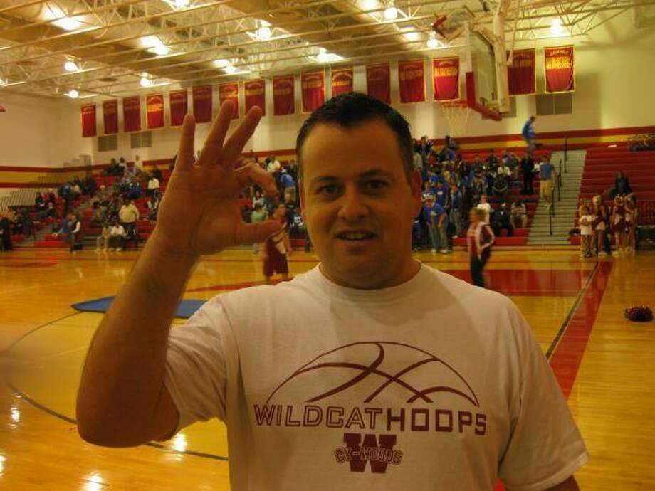 Cy Woods High assistant band director Chris Young has played a big role in Wildcat Athletics. He's also a Kentucky native who's an avid fan of University of Louisville athletics.