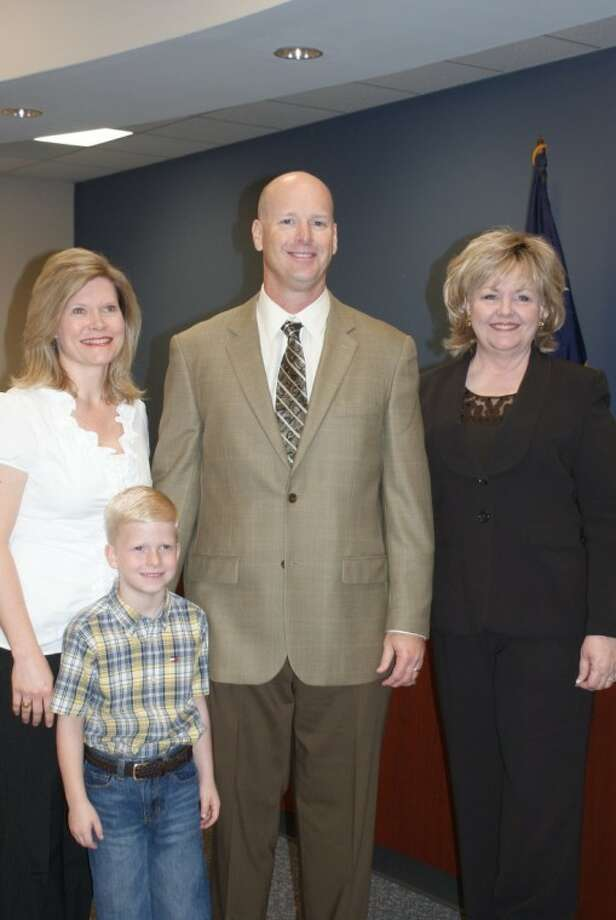 Robert Koopmann was hired as Friendswood's new head football coach and athletic director Friday. With Koopmann are (left to right) his wife, Angela, son Kale, and Friendswood ISD superintendent Trish Hanks. Photo: SUBMITTED PHOTO