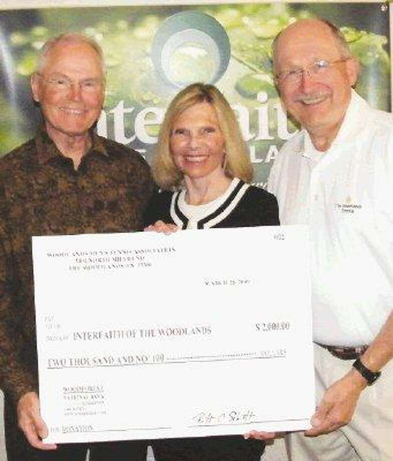 The Woodlands Men's Tennis Association donated $2,000 to Interfaith of The Woodlands. Pictured are Ron Atkinson, Tournament Director of WMTA; Dr. Ann Snyder, President and CEO of Interfaith of The Woodlands; and Ronald C. Laugen, Secretary of WMTA.