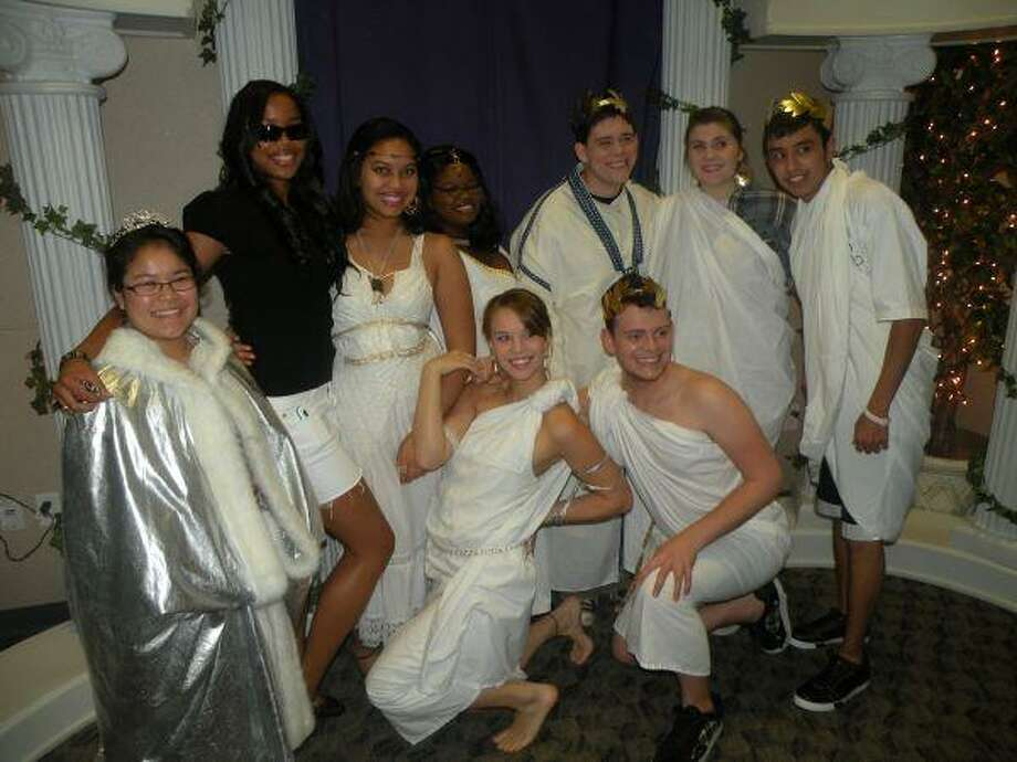 Members of the Lone Star College-Tomball Drama Club were on cue with the Roman Toga theme the annual club awards. Pictured are, top row from left, Francoise Le, Desi Tutt, Therese Crews, Lindsie Felder, Murphy Manley, Sara Brown and Marcos Martinez. Seated from left are Katie Fisher and Greg Overturff.