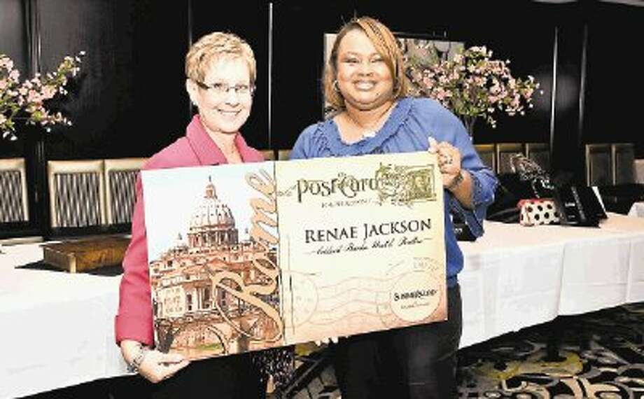 Summerwood's Eileen Bustamante (left) awards the Top Producer prize to Realtor Renae Jackson of Coldwell Banker, who closed 11 new homes in Summerwood last year. / 2011 FrenchBlue Photography