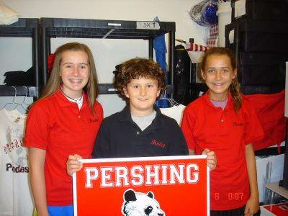 "Pershing Middle School recently held ""Panda Camp"" to introduce incoming pupils to the rigors and rules of middle school. Eighth-grader Kate Loncarich showed school uniforms to incoming sixth-graders Cam Smith and Kate Campbell. School starts Aug. 25."