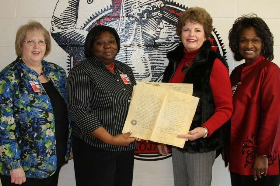 Lincoln Junior High Texas History teacher Paula McClendon accepts antiqued parchment reproductions of several important historical documents from Glenda Shuttlesworth, a member of the John Floyd Chapter of the Daughters of the Republic of Texas/Livingston. The documents were donated to LJH in honor of the 177th anniversary of the siege of the Alamo, which began on Feb. 23, 1836 and lasted until March 6, when the iconic Texas mission fell under the overwhelming forces led by General Antonio Lopez de Santa Anna. Shown from left to right: LJH Principal Penny Spivey, Paula McClendon, Glenda Shuttlesworth and COCISD Community Liaison Carolyn Jefferson. Photo: Submitted Photo