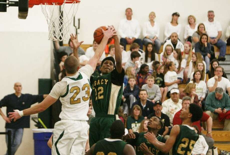 The Woodlands Christian's Justin Jeggle blocks a shot during Friday's TAPPS Class 3A area playoff victory against Legacy Christian. To view or purchase this photo and others like it, visit HCNpics.com.