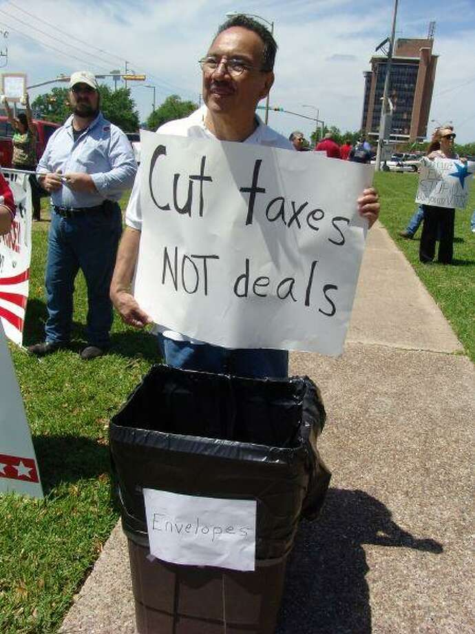 TEA (Taxed Enough Already) Party attendees in front of Pasadena City Hall sported many protest signs on Wednesday.