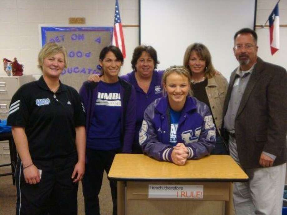 Humble softball star Shelby Worrell signed a letter of intent to play for Our Lady of the Lake University Dec. 13. Pictured, from left, are OLLU head coach Marie Stone, Humble assistant coach Michelle Funderburk, Worrell, Humble head coach Carol Sullivan, mother Misty Worrell and father Royce Worrell.