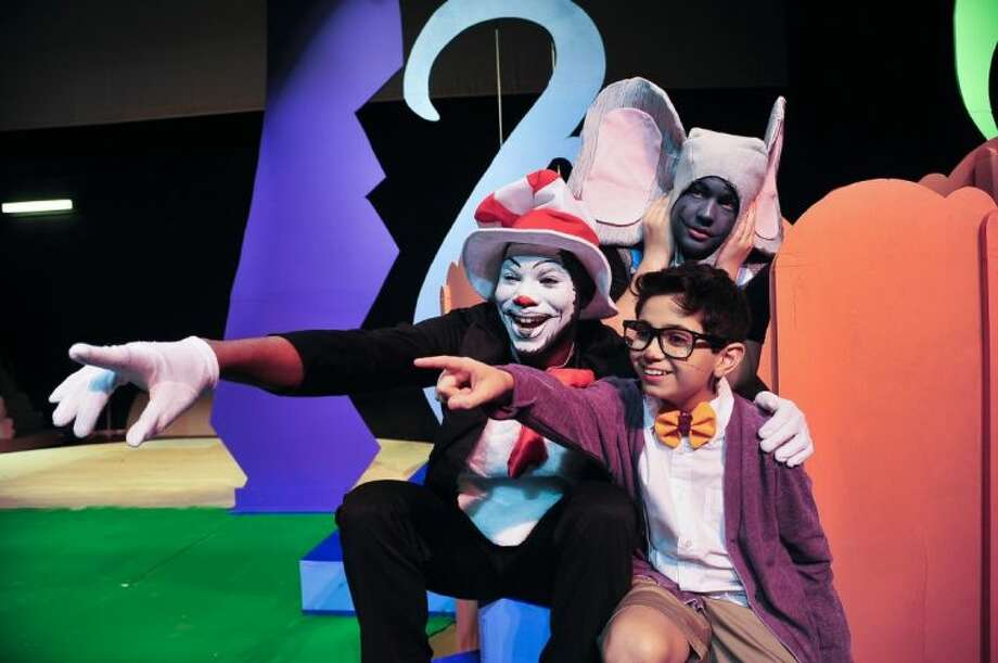 """The Cat in the Hat (Rich Scott from Pearland, left) shows JoJo (Nick Trevino, guest artist from Pasadena) a small Who, as Horton (Travis Terrill from La Porte) looks on in San Jacinto College's production of """"Seussical: The Musical."""" Photo: ROB VANYA"""