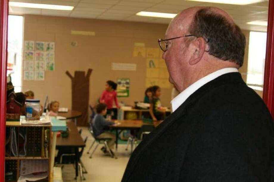 Dale Dixon from ESC Region VI looks in on a full-day pre-kindergarten class during the Splendora ISD District Showcase event Jan. 28.